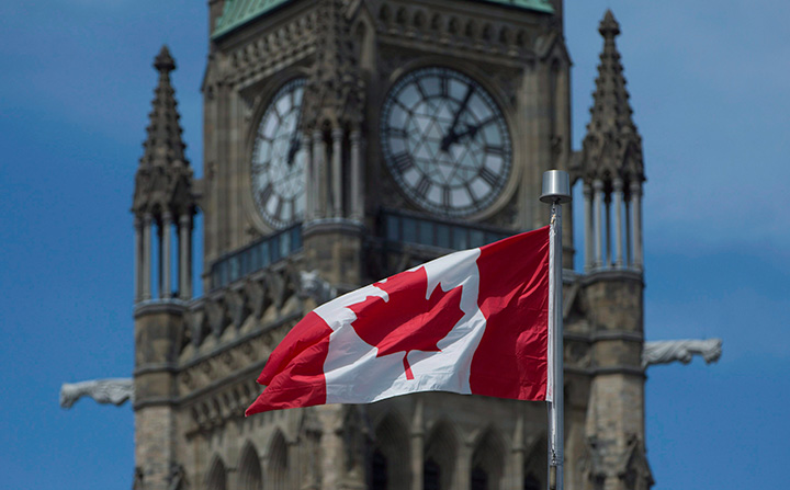 The Maple Leaf flies in front of the Peace tower on Parliament Hill Friday May 6, 2016 in Ottawa.