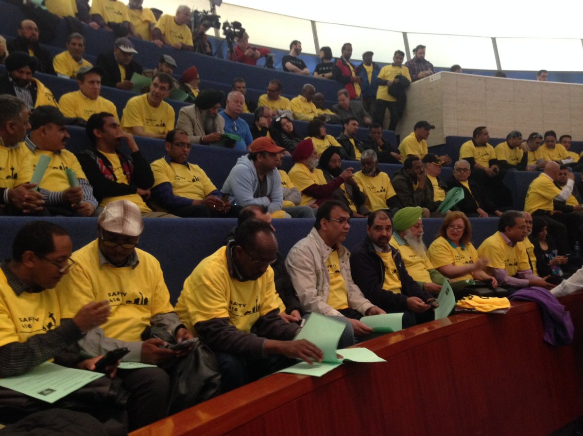 Taxi industry supporters are seen at Toronto city hall on May 3, 2016.