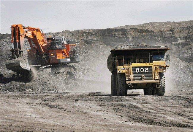 A haul truck carrying a full load drives at an Alberta oilsands mine near Fort McMurray, Alta., on July 9, 2008.