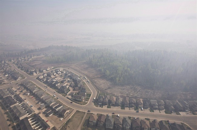 Smoke fills the sky from wildfires over Fort McMurray, Alta., on May 13, 2016.
