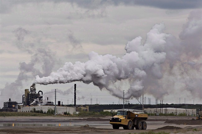 A dump truck works near the Syncrude oil sands extraction facility near the city of Fort McMurray, Alta., on June 1, 2014. A new study in the journal Nature finds that Alberta's oil sands are one of the largest sources of organic aerosol air pollution in North America.