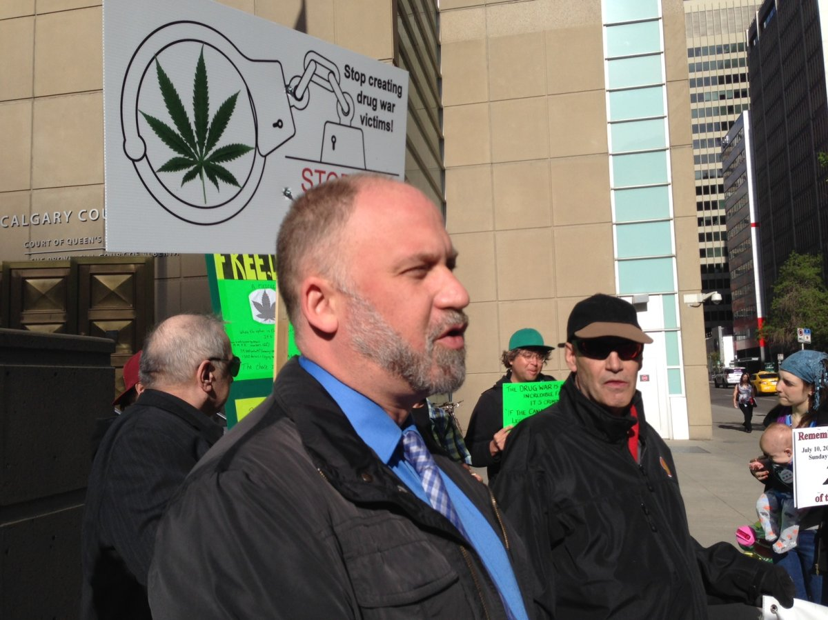 Marijuana activist Dana Larsen speaks to the media outside of a courthouse in Calgary on Wednesday, May 18, 2016.