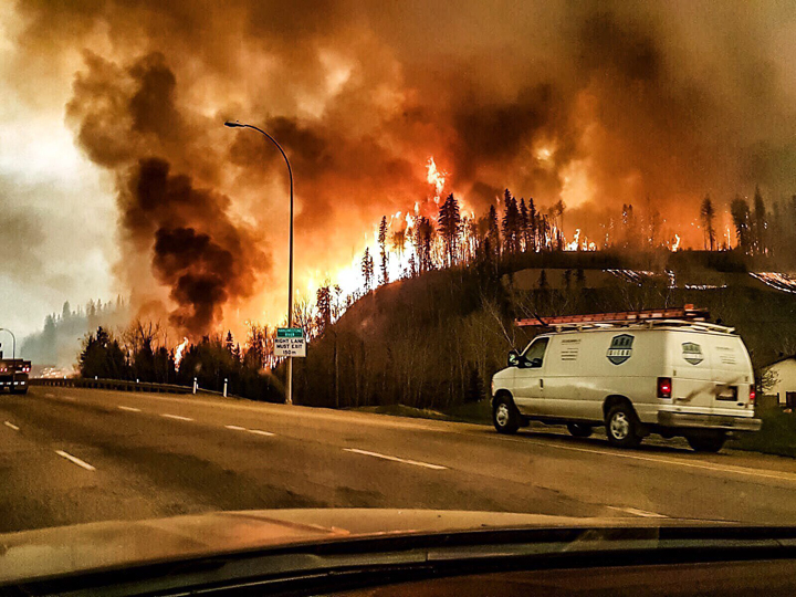 Fire erupts in the forest surrounding Fort McMurray, Alberta, on May 4, 2016.