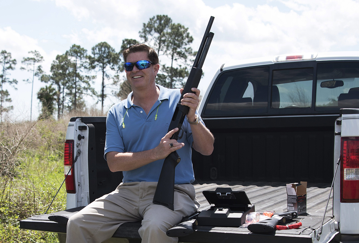 "In this photo taken April 7, 2016, Jonathan Mossberg, whose iGun Technology Corp. is working to develop a ""smart gun,"" poses with the firearm, in Daytona Beach, Fla."