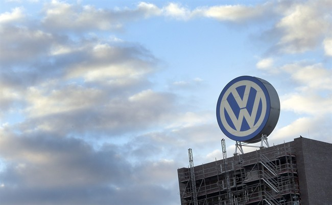 In this Sept. 26, 2015 file photo a giant logo of the German car manufacturer Volkswagen is pictured on top of a factory in Wolfsburg, Germany.