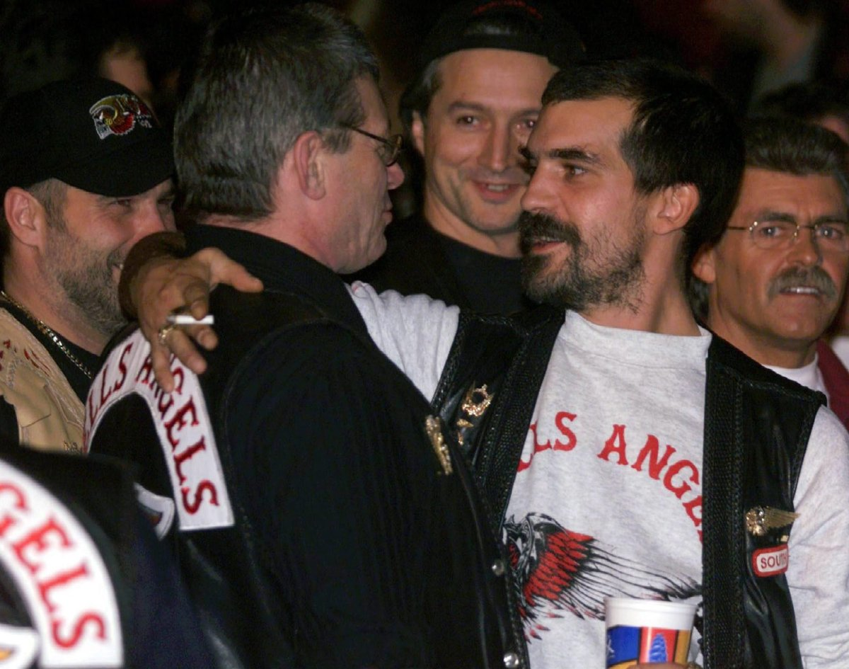 """Hells Angels boss Maurice """"Mom"""" Boucher (2nd left), is greeted by other club members at a boxing match in Montreal."""