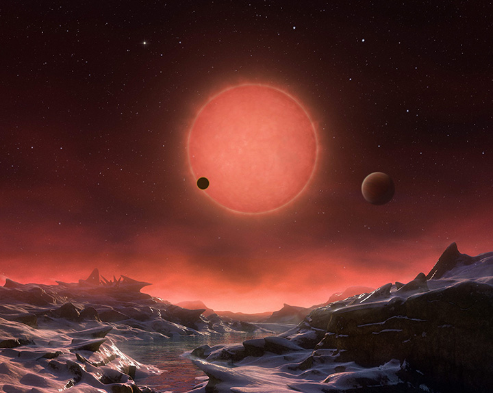 The artist's impression provided by European Southern Observatory on May 2, 2016 shows an imagined view from the surface one of the three planets orbiting an ultra-cool dwarf star just 40 light-years from earth that were discovered using the TRAPPIST telescope at ESO's La Silla Observatory.