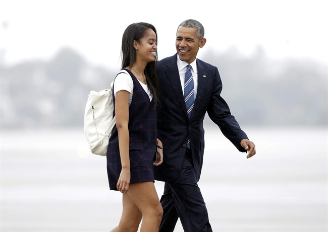 """In this April 8, 2016, file photo, President Barack Obama and his daughter Malia walk from Marine One toward Air Force One at Los Angeles International Airport. Malia is taking a year off after graduating from high school before attending Harvard University as part of an expanding program for students known as a """"gap year.""""."""