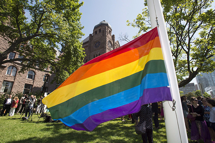 The Pride flag hangs from the flagpole in front of the Ontario legislature at Queen's Park in Toronto on Monday, June 22, 2015.