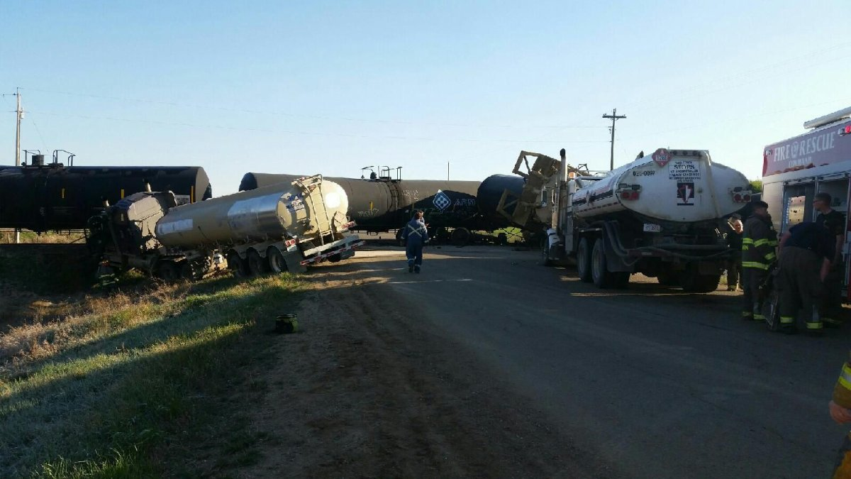 A train is derailed near Vermilion, Alberta after it collides with a fluid hauler truck, Friday, May 13, 2016.