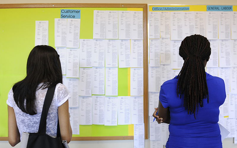 Zohra Surani,21, left and Melinda Cuffy, 23, pore over jobs listings at the Summer Jobs Services centre in downtown Toronto.