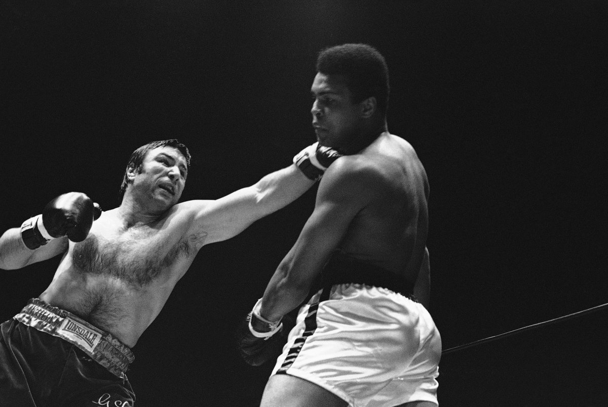 FILE - In this May 1, 1972, file photo, George Chuvalo connects with a left to the head of Muhammad Ali in the first round of their scheduled 12-round fight in Vancouver.