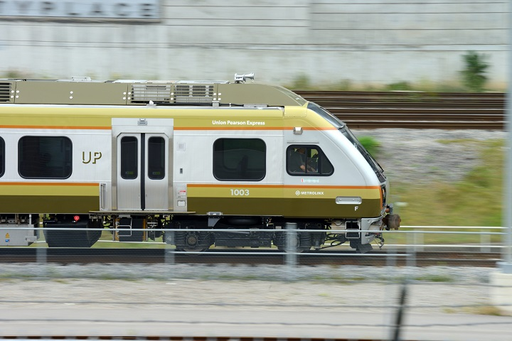 The Union-Pearson Express train is pictured in motion as it rides along the rail, in Toronto on August 29, 2015.