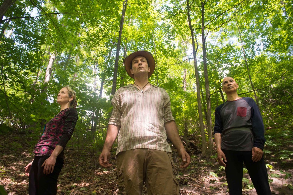Ben Porchuk, center, head of the Canadian chapter of the Association of Nature and Forest Therapy Guides and Programs, poses with Ruthanne Henry, left, and Real Eguchi during a session of forest therapy at Sunnybrook Park, in Toronto, on Friday, June 3, 2016.