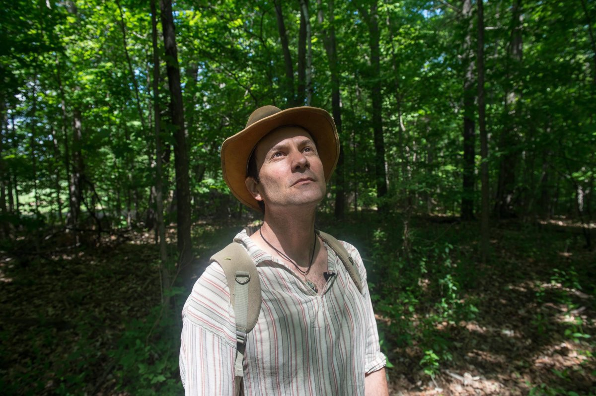 Ben Porchuk, head of the Canadian chapter of the Association of Nature and Forest Therapy Guides and Programs, poses during a session of forest therapy at Sunnybrook Park, in Toronto, on Friday, June 3, 2016.