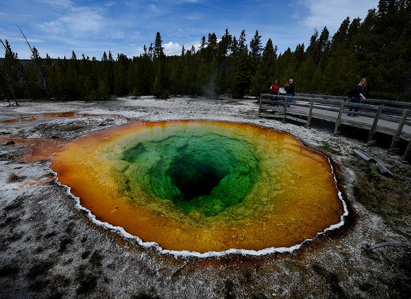 Tourists view the Morning Glory hot spring in the Upper Geyser Basin of Yellowstone National Park in Wyoming, on May 14, 2016.