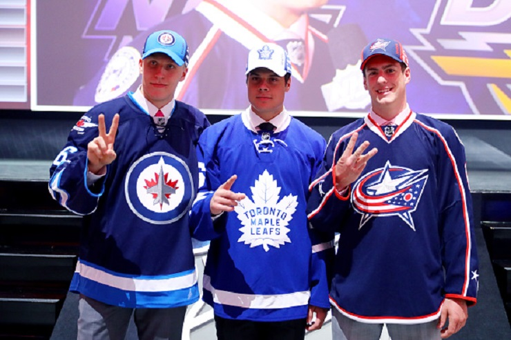 The players flanking 2016 first overall pick Auston Matthews are swapping jerseys — Laine was selected by the Winnipeg Jets second overall, and Dubois followed one pick later, going to Columbus.