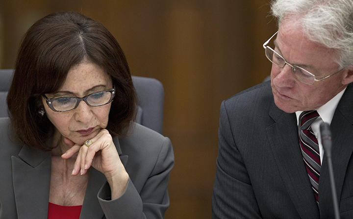 Information and Privacy Commissioner Brian Beamish is seen with former commissioner Ann Cavoukian during questioning at a legislative committee probing the gas plant scandal June 25, 2013 in Toronto.