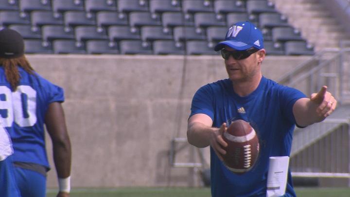 Winnipeg Blue Bombers head coach Mike O'Shea runs a drill during practice.