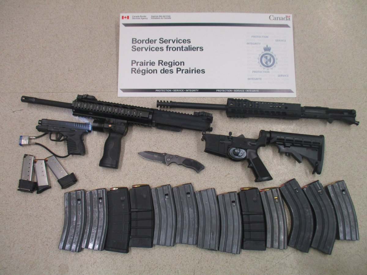 On May 26 CBSA officers found a undeclared .45 calibre pistol, 13 overcapacity magazines, a prohibited switchblade, and a prohibited AM-15 semi-automatic assault rifle.