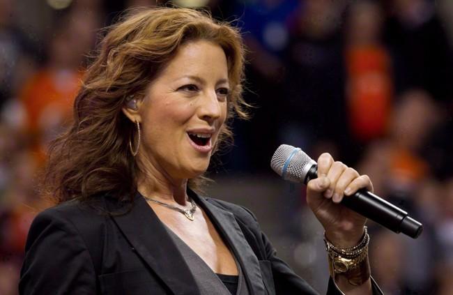 Canadian singer Sarah McLachlan sings the national anthem at B.C. Place stadium in Vancouver, B.C., on September 30, 2011.