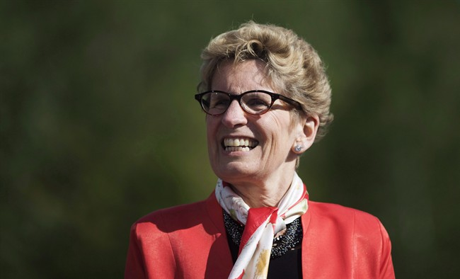 Ontario Premier Kathleen Wynne looks on before making a climate change policy announcement at Evergreen Brickworks in Toronto, Wednesday, June 8, 2016.
