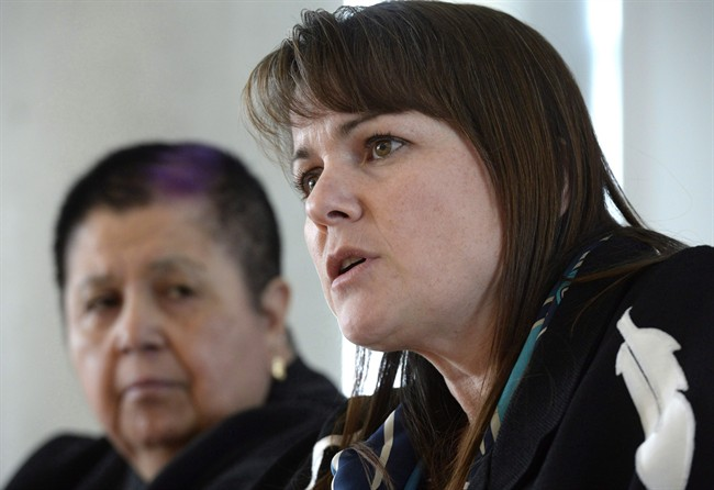 Dawn Lavell-Harvard, President of the Native Women's Association of Canada, speaks to reporters while Shelley McIvor of the Canadian Feminist Alliance for International Action listens on Jan. 31, 2016. Status of Women Canada will soon allow groups advocating for women and girls to receive federal project funding, reversing a controversial policy the previous Conservative government brought in nearly a decade ago.