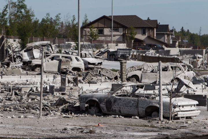 Burned-out homes and vehicles are seen in the Timberlea neighbourhood as residents re-enter fire-ravaged Fort McMurray, Alta., on Thursday, June 2, 2016.