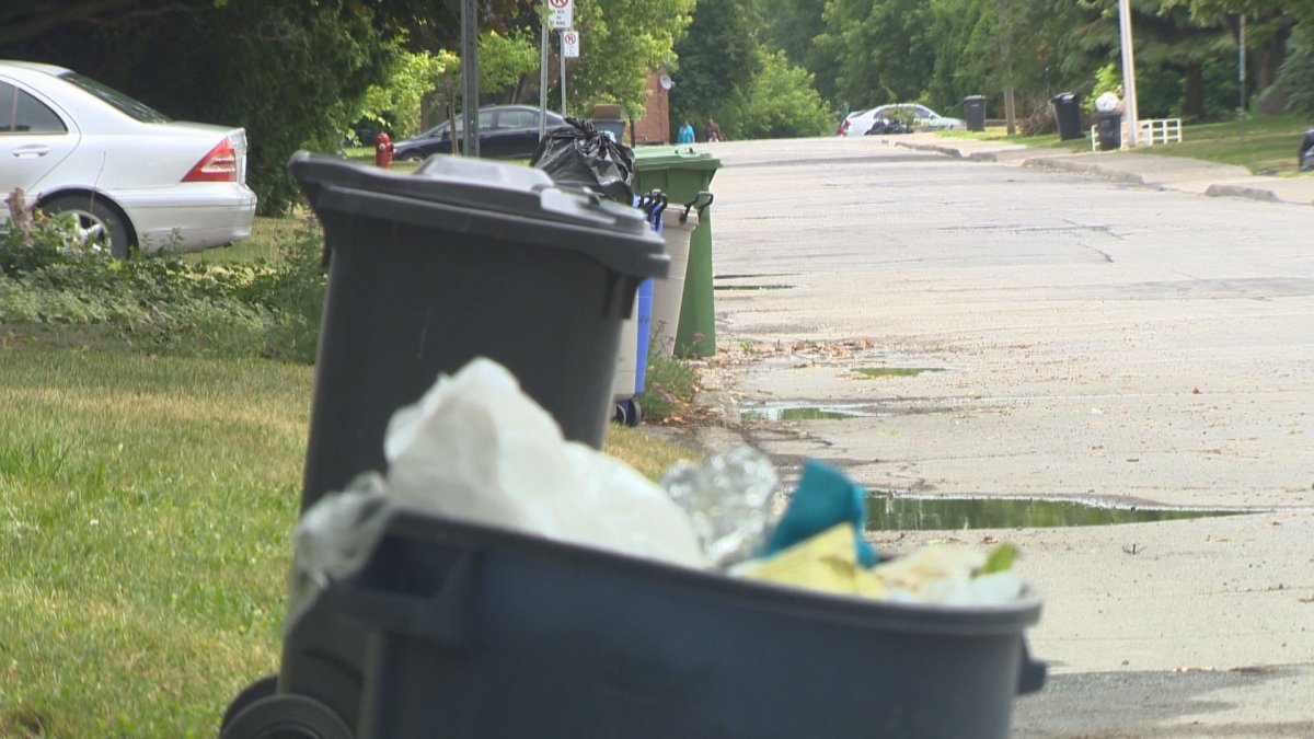 Trash sits on the roadside for bi-weekly pick-up in Pointe-Claire, Wednesday, June 29, 2016.