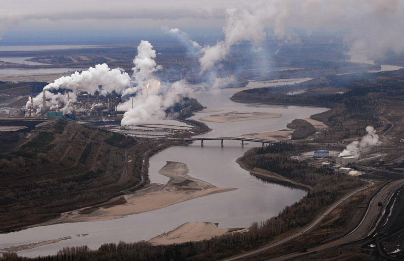Aerial view of the Suncor oilsands extraction facility on the banks of the Athabasca River and near the town of Fort McMurray, Alberta.