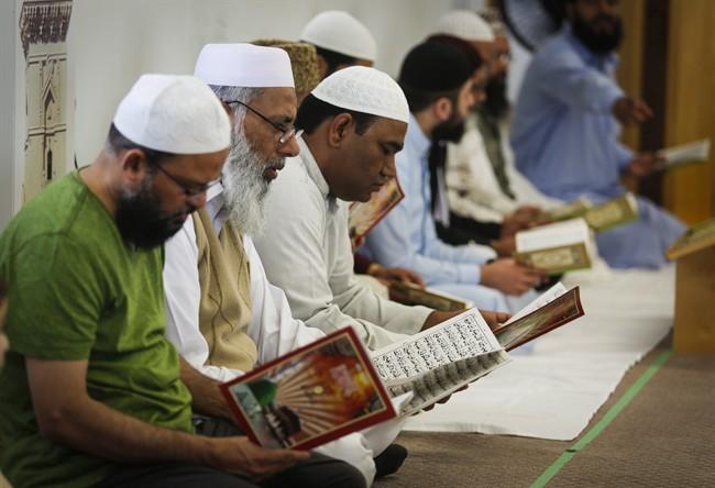 Men pray at a mosque in Calgary, Alta., Sunday, June 5, 2016.