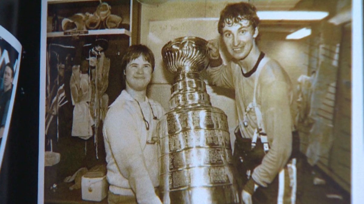 Joey Moss with Wayne Gretzky and the Stanley Cup.