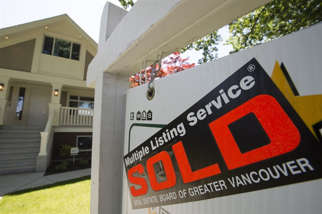 A sold sign is pictured outside a home in Vancouver, B.C.