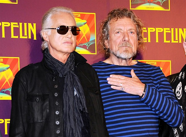 "In this Oct. 9, 2012 file photo, Led Zeppelin guitarist Jimmy Page, left, and singer Robert Plant appear at a press conference ahead of the worldwide theatrical release of ""Celebration Day,"" a concert film of their 2007 London O2 arena reunion show, in New York."