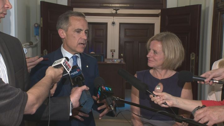 Bank of England Governor Mark Carney speaks to reporters along with Premier Rachel Notley in Edmonton on June 6, 2016.