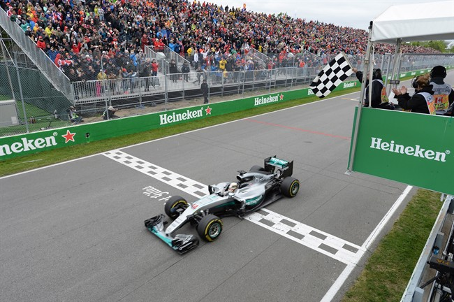 Mercedes driver Lewis Hamilton of Great Britain crosses the finish line to win the Canadian Grand Prix.