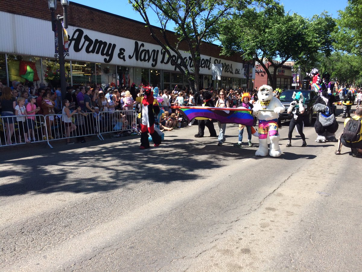 Edmontonians gather on Whyte Avenue to watch the Edmonton Pride Parade on June 4, 2016.
