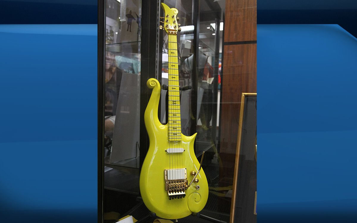 A Prince owned and played custom made signature yellow cloud guitar (Circa 1988-1994) is displayed during a media preview June 22, 2016 at Heritage Auctions in Beverly Hills, California. The guitar is one of the items offered in a live auction June 24-25.