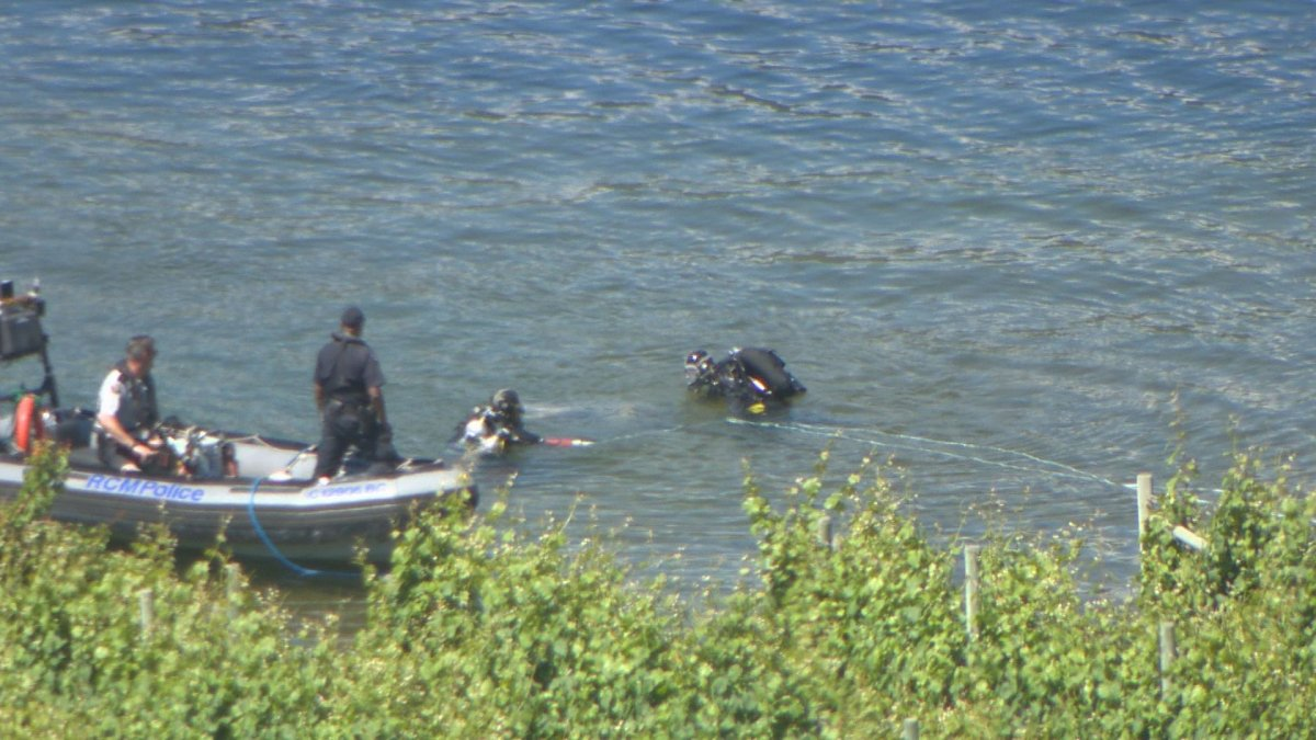 A RCMP dive team searches for a Lake Country woman who went missing following a canoe accident.