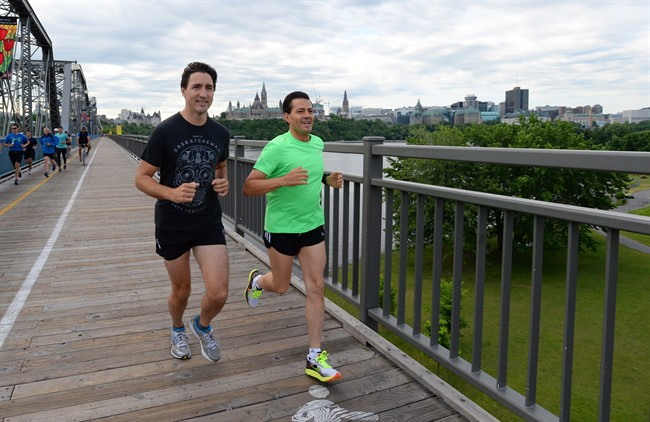Prime Minister Justin Trudeau and Mexican President Enrique Pena Nieto run across the Alexandra Bridge from Ottawa to Gatineau, Quebec on Tuesday, June 28, 2016.
