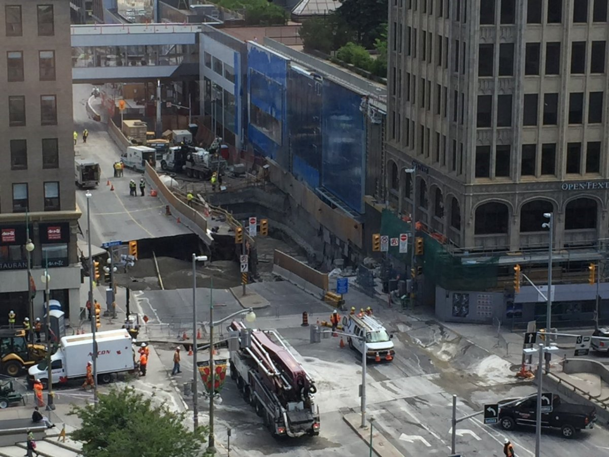 This image of the sinkhole at the corner of Sussex Drive and Rideau Street in downtown Ottawa was taken on Thursday, June 9, 2016. Crews were working to fill the hole with concrete.