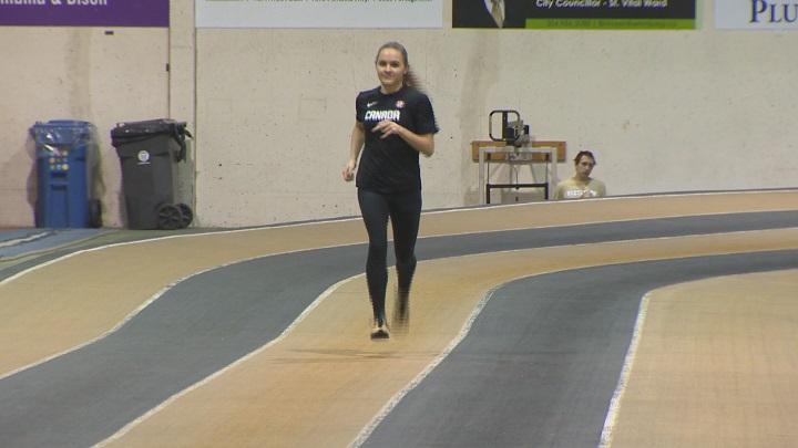 Victoria Tachinski jogs at the University of Manitoba field house.