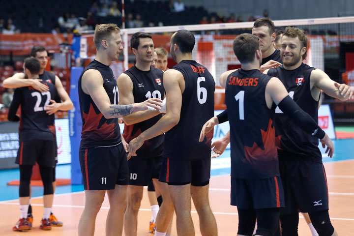 Canada's volleyball team members celebrate after a win over China during their Men's Volleyball World Olympic qualification tournament match in Tokyo, Sunday, June 5, 2016.
