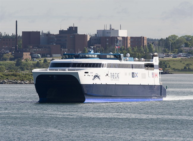 The CAT, a high-speed passenger ferry, departs Yarmouth, N.S., heading to Portland, Maine, on its first scheduled trip on Wednesday, June 15, 2016.