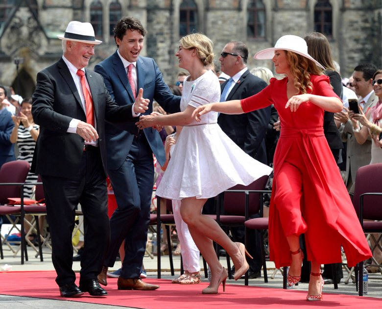 Governor General David Johnston, left to right, Prime Minister Justin Trudeau, Minister of Canadian Heritage Melanie Joly and Sophie Gregoire Trudeau dance during Canada Day celebrations on Parliament Hill.