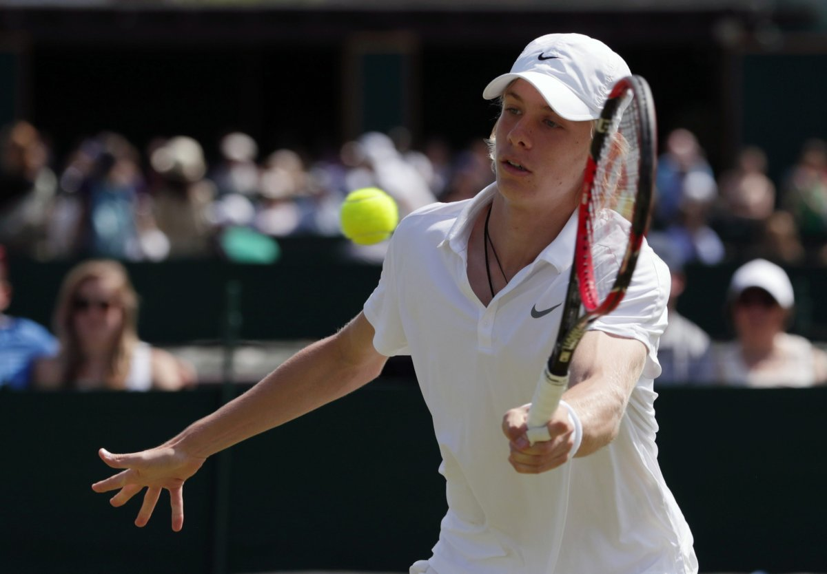 Denis Shapovalov of Canada plays a return to Yunseong Chung of Korea during their boy's singles match on day ten of the Wimbledon Tennis Championships in London, Wednesday, July 6, 2016.