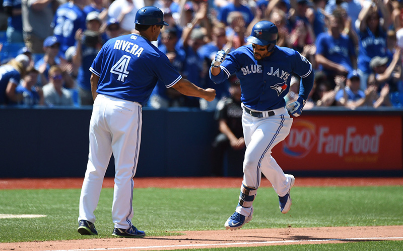Toronto Blue Jays' Devon Travis rounds third base after hitting a solo home run during fifth inning MLB baseball action against the Baltimore Orioles, in Toronto on Saturday, July 30, 2016.