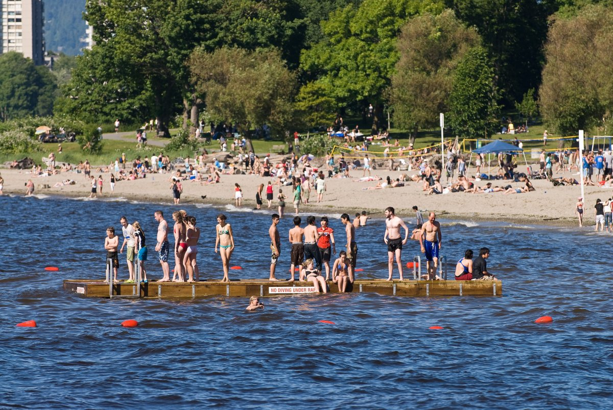 Hot, sunny weather brings out the crowds to Kitsilano beach on Vancouver's English Bay.