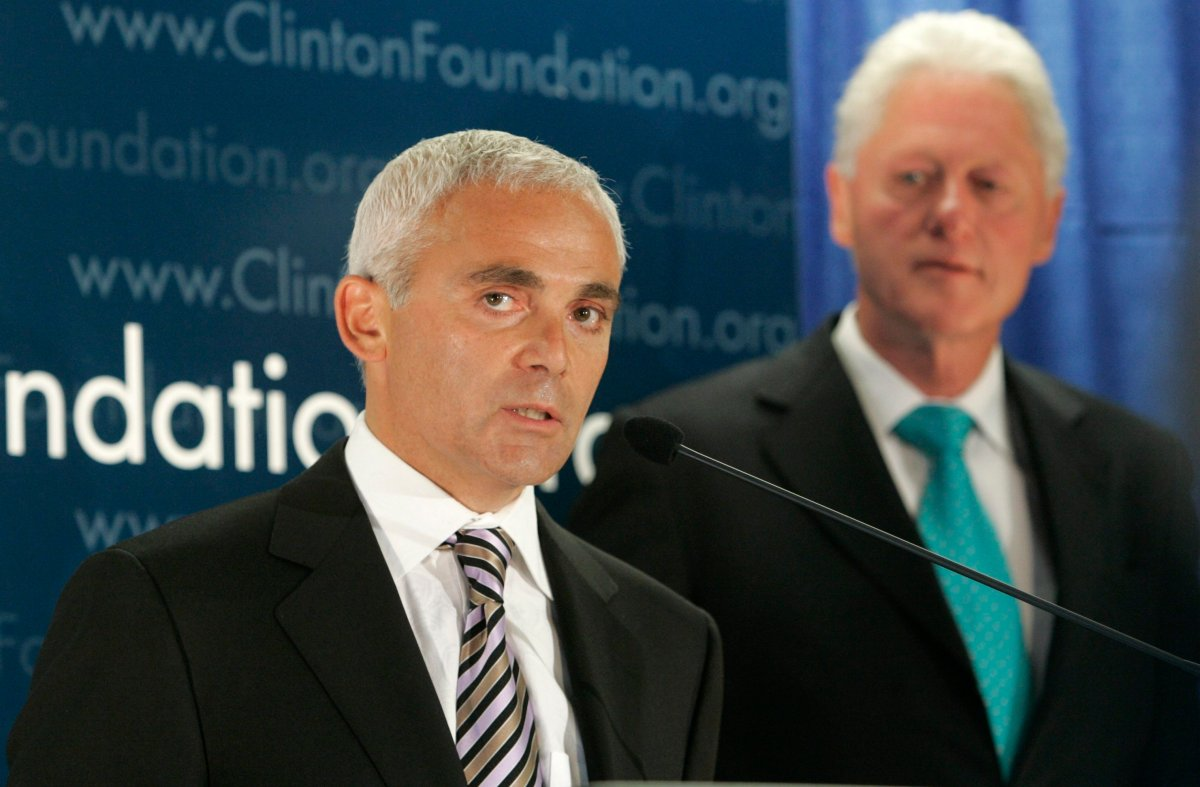 In this June 21, 2007 file photo, Frank Giustra, a Canadian businessman, speaks as former President Bill Clinton looks on during a news conference in New York.