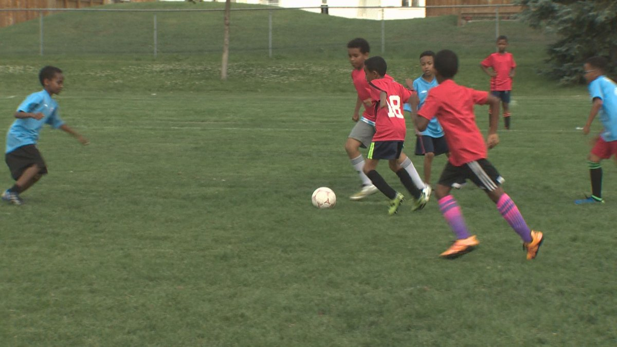Children participate in the All-African Soccer Tournament .
